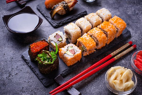 Food Stock Photos: Yulia Furman - Sushi and roll set on black table