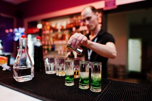 Bartender in work at bar