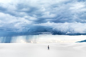 man alone in vast white sands