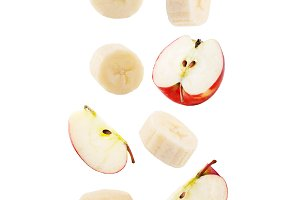 Falling apple and banana isolated