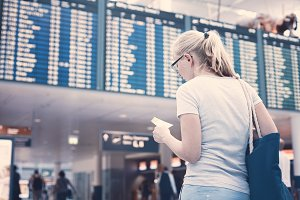 Woman near airline schedule