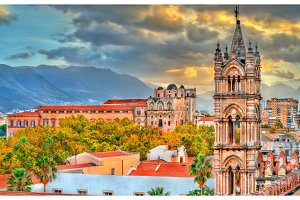 Tower of Palermo Cathedral and Palazzo dei Normanni at sunset - Sicily, Italy