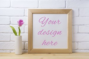 Wooden square frame mockup with pink