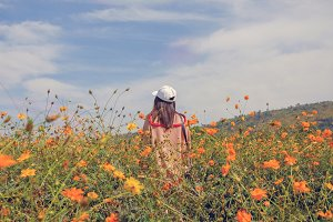 Woman standing in the flowers field