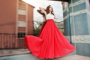 Fashionable girl evening red dress