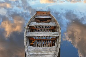 Wooden boat on the lake in autumn