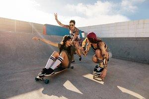 Female friends enjoying skateboard