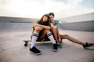 Female skateboarders hanging out