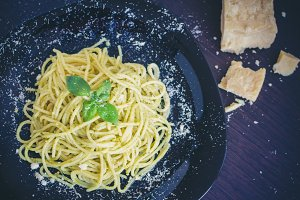 Italian pasta spaghetti with homemade pesto sauce and basil leaf