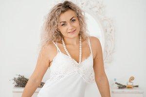Curly blonde girl in underwear