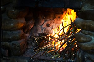 Fire in a rustic fireplace