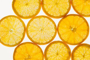Fresh fruit slices abstract seamless pattern background, oranges