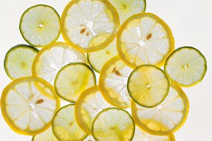 Citrus fruit slices abstract pattern background, lemons and lime