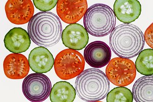 Fresh vegetables slices abstract pattern background,onion, cucum