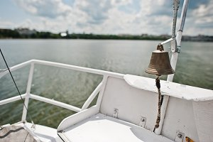 Iron bell on a small yacht at lake.