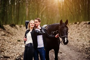 couple in love near horse