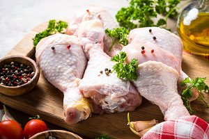 Chicken drumsticks. Raw meat.