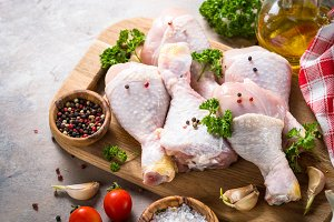Chicken drumsticks and cooking ingredients.