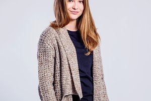 Girl in jeans and long sweater, woman, studio shot