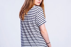 Girl in jeans and striped t-shirt, woman, studio shot