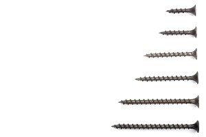 black screws isolated on white background with copy space for your text. Top view.