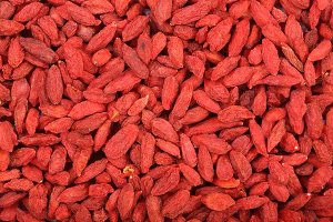 Dried goji berries as a background close up