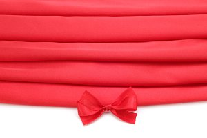 red silk fabric with bow
