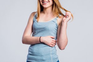 Girl in jeans and singlet, young woman, studio shot