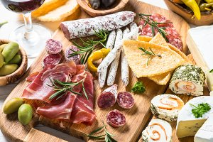 Antipasto delicatessen - meat, cheese and wine.