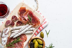 Traditional italian antipasto on white.