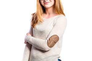 Girl in jeans and sweatshirt, young woman, studio shot