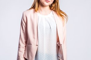 Girl in jeans and pink jacket, woman, studio shot