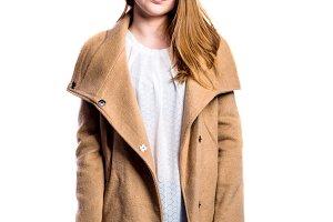 Girl in jeans and brown coat, woman, studio shot