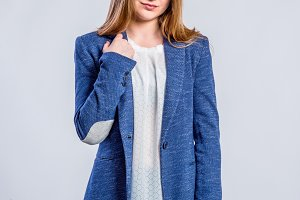 Girl in jeans and blue jacket, woman, studio shot