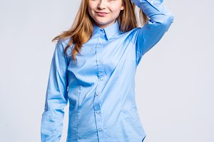 Girl in jeans and shirt, young woman, studio shot