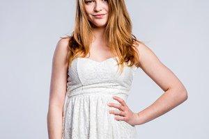 Girl in white lace summer dress, woman, studio shot