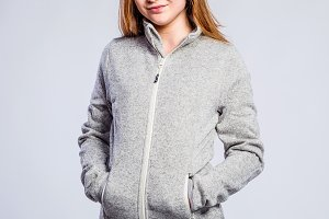 Girl gray hooded sweatshirt, young woman, studio shot