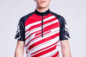 Boy in striped sports t-shirt, young man, studio shot