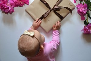 Little baby girl with present