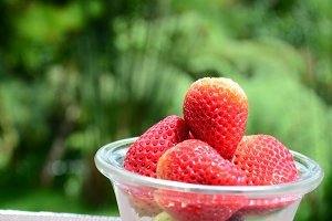 Ripe strawberries in glass bowl.