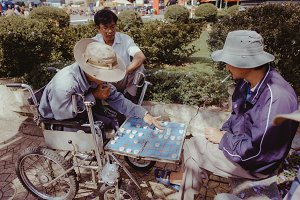 Two old man are playing chess