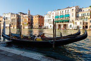 Grand Canal. gondolas on the pier await passengers. Sunny summer evening
