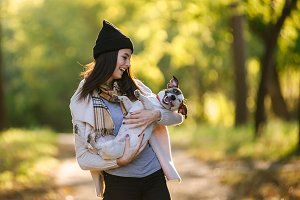beautiful girl playing with a dog. P