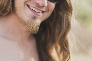Attractive man with sunglasses in outdoors portrait