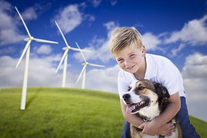 Young Boy and Dog by Wind Turbines