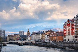 Church, Isere river and bridge in Grenoble, France