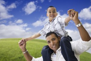 Hispanic Father and Son by WIndmills