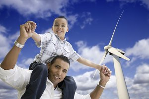Hispanic Father and Son by Windmill