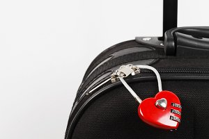 Black suitcase and red lock