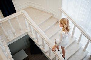 Blonde girl on white dress